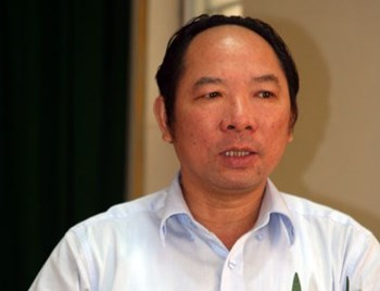 Phan Minh Nguyet, Hanoi's deputy director of agriculture, has been arrested for problems at his former state firm. Photo credit: Lao Dong