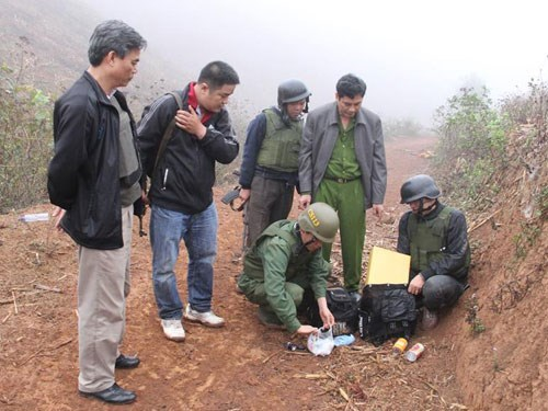 A Son La Police's photo shows officers checking the site of a gunfight that killed one smuggler near the Laos border on March 7, 2015.
