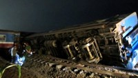 Officers examine the site of a crash between a train and a truck in Quang Tri Province the night of March 10, 2015. Photo: Vu Vu