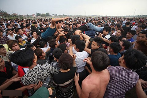 Men climb over each other to fight for some sacred offerings at a spring festival in northern Vietnam. Photo credit: Zing.vn