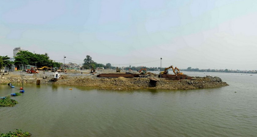Construction materials have encroached on a part of the Dong Nai River to make ground for a development project. Photo: Le Lam