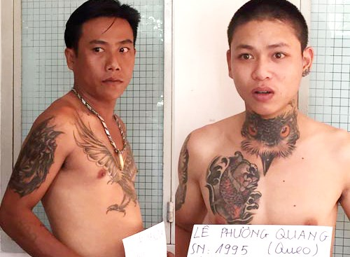 Two of the 63 gangsters arrested by Tien Giang Police as they were on their way to deal with a rival gang. Photo credit: Nguoi Lao Dong