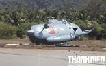 A Vietnam's military helicopter crashes on Phu Quy Island in central Vietnam on March 26, 2015. Photo: Tho Chau