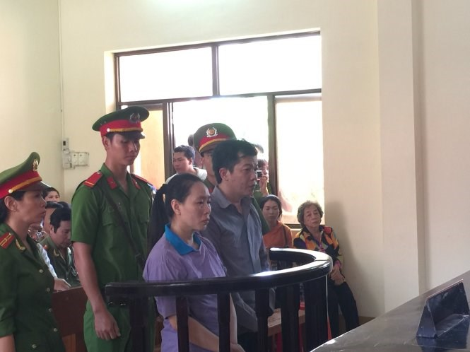Two cops stand trial in Kien Giang Province March 26, 2015 for cooking the books, stealing nearly $630,000. Photo credit: Tuoi Tre