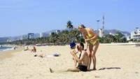 A foreign couple with their child at a beach in Nha Trang. Photo credit: Khue Viet Truong/tcdulichtphcm