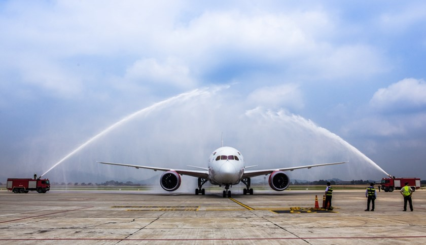 Trucks spray water at a Boeing aircraft of Kenya Airways in Hanoi March 31, 2015 as part of the launching ceremony of its direct route from Nairobi to Hanoi. Photo credit: Dan Tri