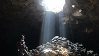 Sun shines through a hole into a cave of the Chu Bluk lava cave system in Dak Nong Province. Photo credit: Tuoi Tre