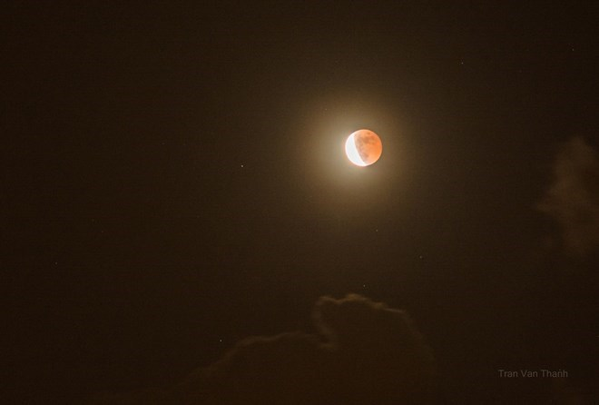 A red moon appears above Hanoi, Vietnam, October 8, 2014 in a photo captured by a member of Hanoi's astronomy club Human and Space
