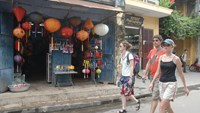Foreign tourists pass a lantern shop in the historic town of Hoi An. Photo: Diep Duc Minh