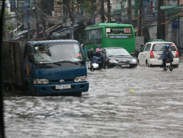 A street in Ho Chi Minh City is flooded after a heavy rain. File photo