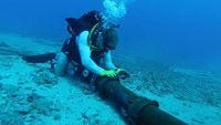 A diver checks an undersea cable. File photo