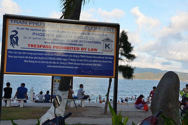 A notice board put up at a Nha Trang beach says the area is going to be a luxury apartment tower soon. Photo credit: Lao Dong
