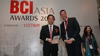 Le Minh Dung (L) represents BIM Group to receive the award at the ceremony in Ho Chi Minh City May 22, 2015.