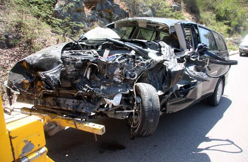 A car is badly damaged after crashing into a truck in Nha Trang on Thursday. Photo: VnExpress