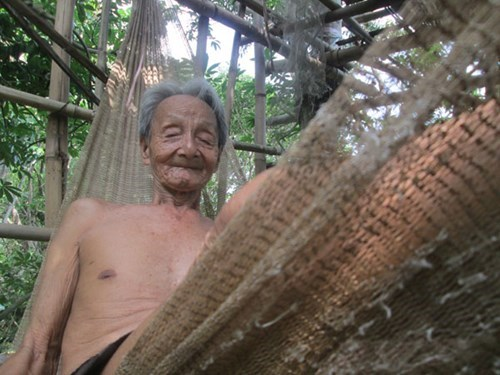 Duong Van Duong on a hammock on his treehouse in An Giang Province. Photo: Thanh Dung
