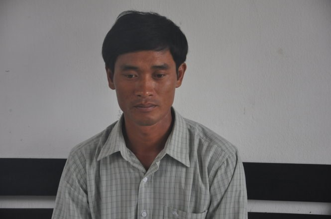 Danh Song, 32, who set his wife on fire after coming home drunk and she refused to share his bed. Photo credit: Tuoi Tre
