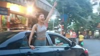 Police search for Hanoi revelers who turned car into dance club