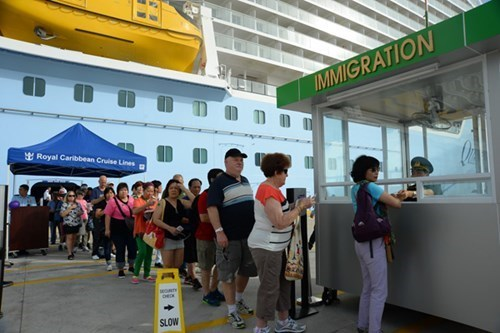 Tourists from US cruise ship Quantum of the Seas register to visit Vung Tau and Ho Chi Minh City on June 17, 2015. Photo: Diep Duc Minh
