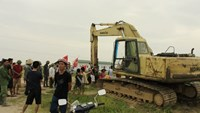 Video shows woman crushed by excavator during land protest in Vietnam