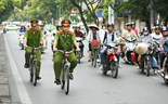 Hanoi police start patrolling on bicycles to build friendly image