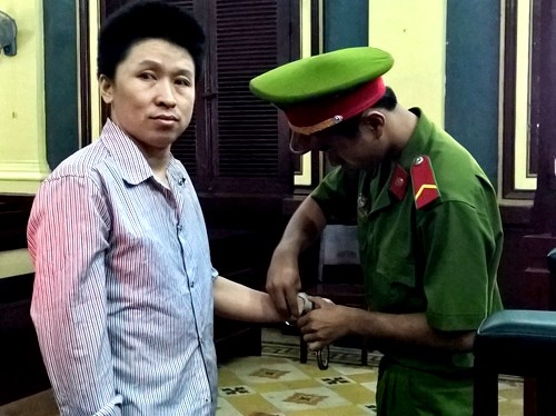 Wang Yiming at a court in Ho Chi Minh City on August 12, 2015 for stabbing his marriage broker. Photo credit: VnExpress