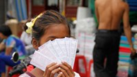 Vietnamese woman accused of burning daughter for poor lottery ticket sales