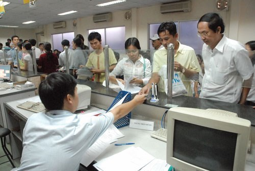 People file business registration forms in Ho Chi Minh City. Photo: Diep Duc Minh