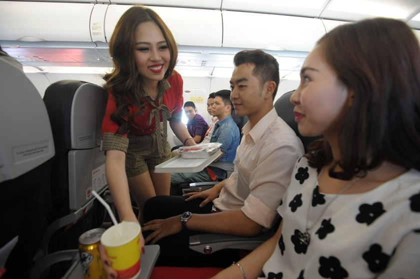 Customers are served on a Vietjet flight.
