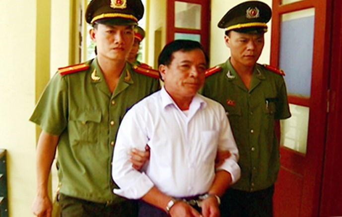 A photo provided by Thanh Hoa police shows Nguyen Dinh Tan, a commune chairman, arrested for creating fake mental illness cases