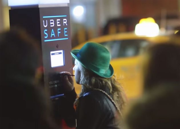 A photo from Uber shows a woman using its breathalyzer in Toronto, Canada
