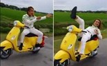 Vietnamese fined $260 for riding motorbike hands-free, lying on seat