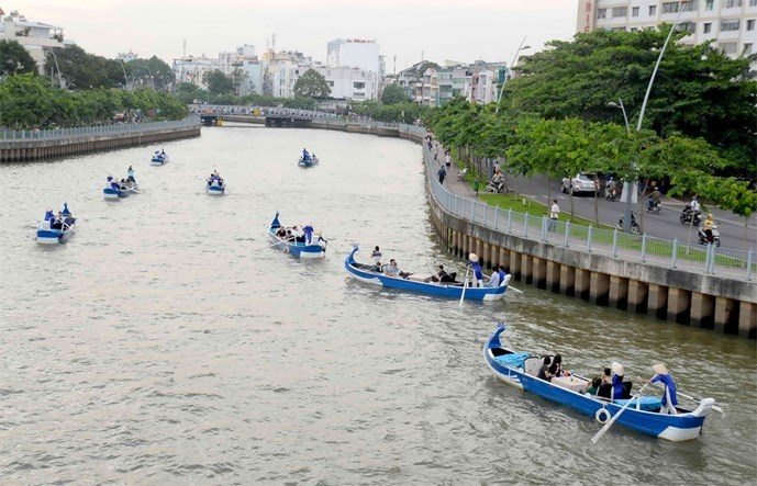 Tourists sail wooden boats along the Nhieu Loc-Thi Nghe Canal in Ho Chi Minh City. Photo: Diep Duc Minh