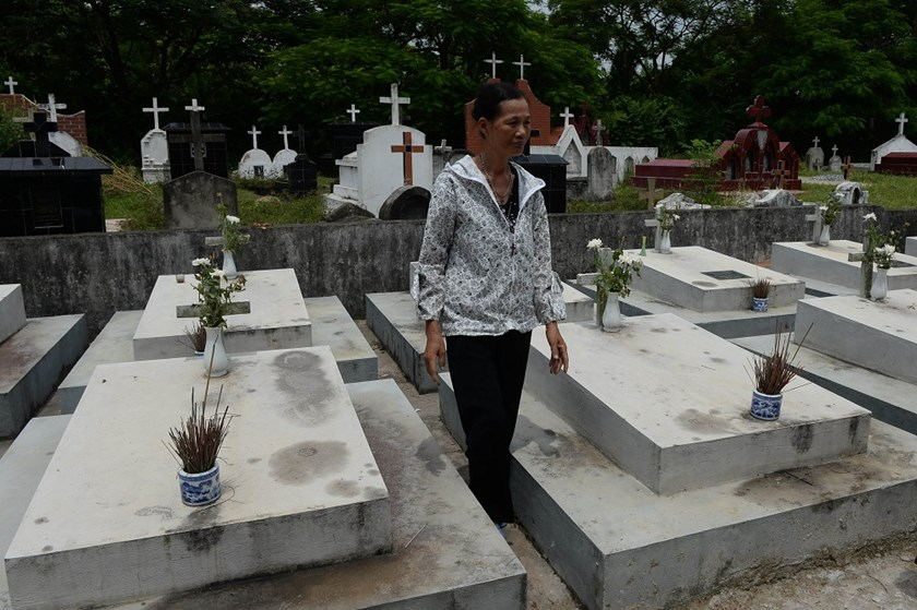 A woman stands next to collective graves for fetuses at a cemetery on the outskirts of Hanoi. Vietnam has the highest abortion rate in Asia. Photo credit: AFP
