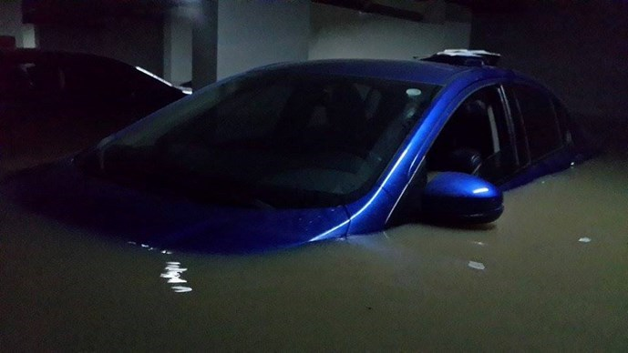A photo provided by a Green Hills resident shows his car in the building's flooded basement on September 15, 2015.