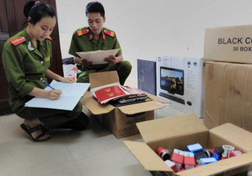Hanoi police checks a house where fake degrees are made. Photo credit: VnExpress