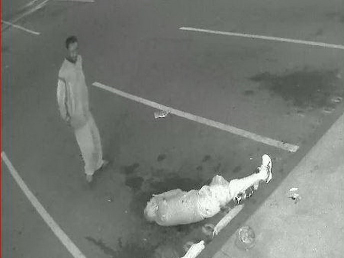 A screen shot from surveillance camera footage shows the 83-year-old Vietnamese man lying on the ground after being punched and kicked by the other in Santa Ana.