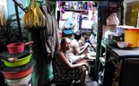 Down a Saigon alley, tiny houses and big families
