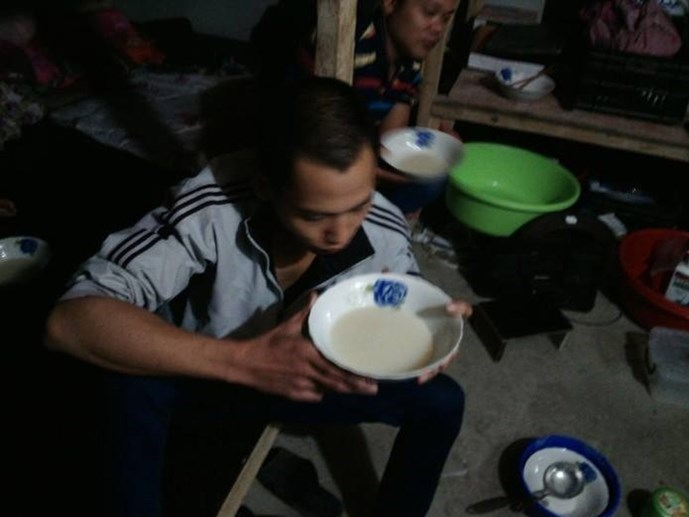 A photo provided by Vietnamese workers in Algeria shows one of them having porridge as his Chinese boss has starved him and others since mid-September after they refused to work on altered wage condition.