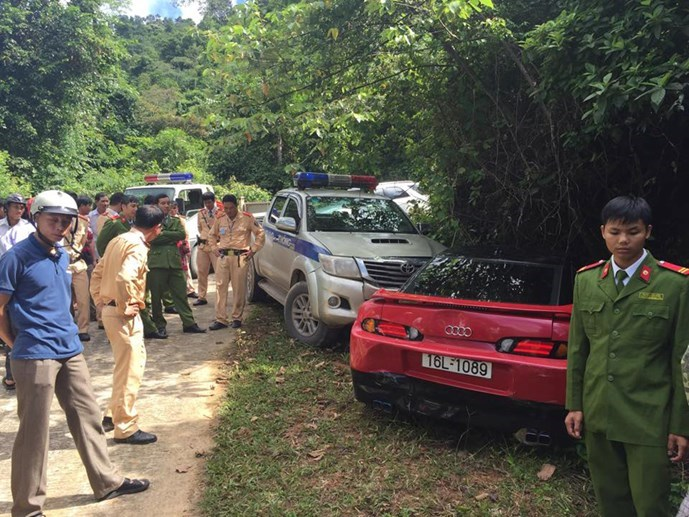 A photo provided by police in Ha Tinh Province shows officers surrounding the red car carrying 11 kilograms of marijuana on November 11.