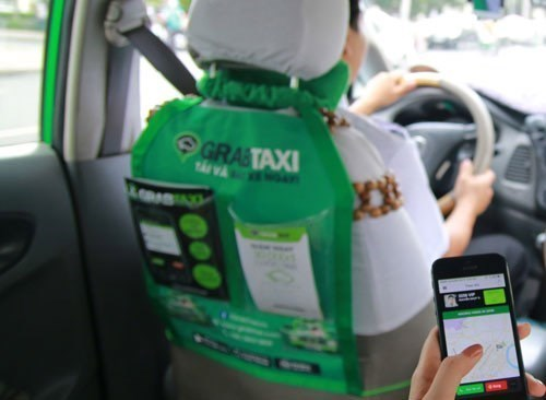 A taxi that accepts the mobile booking app GrabTaxi. Photo: Thanh Luan