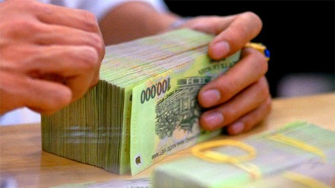 Government officials can become corrupt as their salaries are low and there are legal loopholes that they can make use of, Hanoi government said in a report. File photo