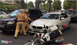 Car driver knocks down police bike after being pulled up for double crash