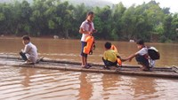 Children in northern Vietnam sail a raft to school. Drowning is a leading cause of death among children in the country. Photo credit: Zing