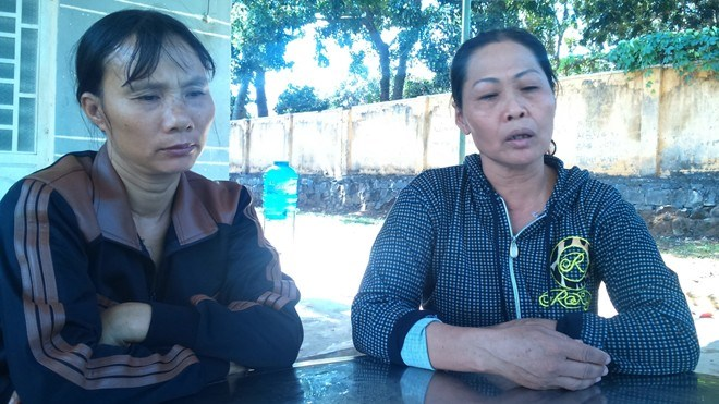 "The boy's mother (L) calls his death ""abnormal"" and demands an investigation. Photo: Mnh Quy/Zing"