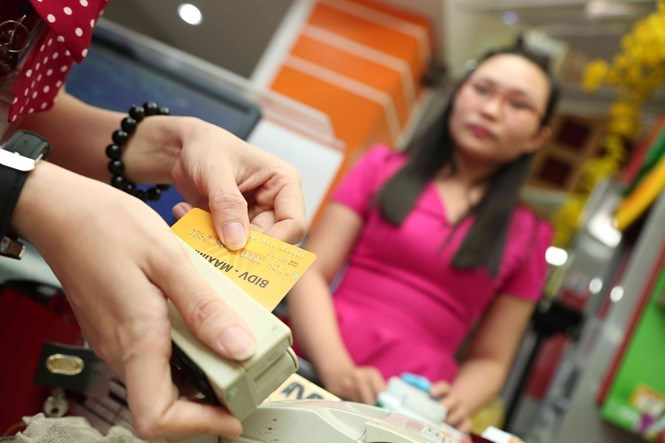Most ATMs in Vietnam use simple technology that criminals can easily make a fake card to fit in, experts said. Photo: Dao Ngoc Thach