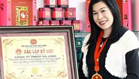 Ha Thuy Linh poses with a certificate given to her family for a tea making performance in a file photo. Photo: Lam Vien