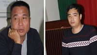 A photo from police shows two Chinese arrested for cheating a gold shop in Dong Nai Province into buying 58 ounces of fake gold on December 2.
