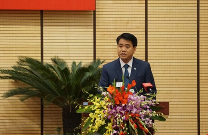 Nguyen Duc Chung, Hanoi's new chairman, at a meeting. File photo
