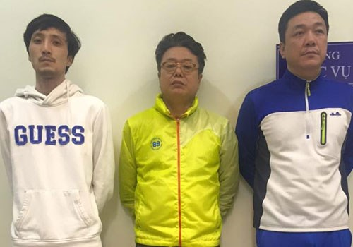 A photo from Hanoi police shows three South Koreans who were arrested for making withdrawals using fake credit cards.