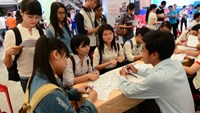 University students look for employment opportunities at an event in Ho Chi Minh City. Photo: Quang Dinh/Tuoi Tre